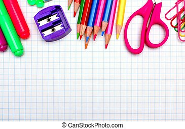 Colorful school supplies border over graphing paper -...
