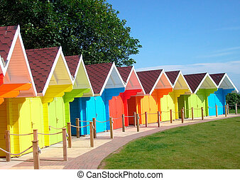 Exteriors of beautiful bright seaside beach chalets, Scarborough, England.