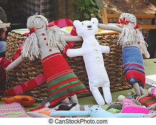 sewed handmade dolls - colorful sewed handmade dolls on a...