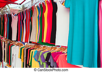 Colorful shirts for sale at market