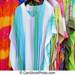 Colorful shirts for sale in outdoor market