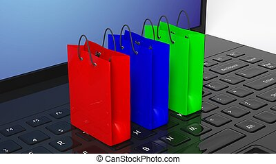 Colorful shopping bags on black laptop keyboard