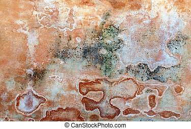 sinter in different colors on a plastered wall