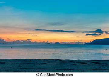 Colorful sky at amazing dawn over ocean on beach