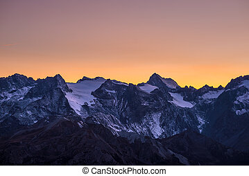 Colorful sky at dusk beyond the glaciers on the majestic...