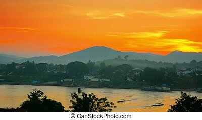 Colorful Sky over River in Laos at Sunset