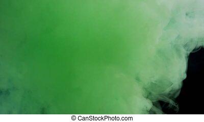 Colorful Smoke on Dark Background - Green smoke on black...