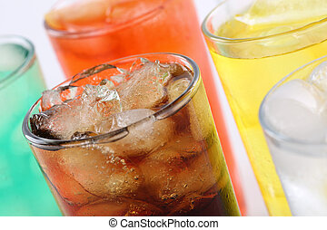 Colorful soda drinks with cola, soft drinks with ice cubes