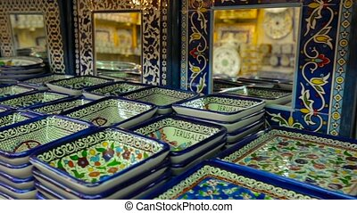 Colorful souvenir plates in blue dolly