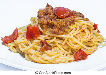 Colorful spaghetti with cherry tomatoes and peppers sauce
