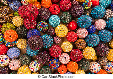 Colorful sparkling balls of jewelery beads display.