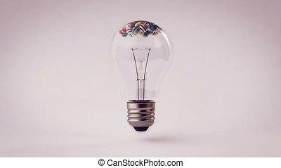 """Colorful spheres animation inside a light bulb"""