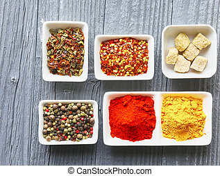 Colorful spices on a dark concrete background