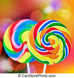 Colorful spiral lollipop isolated on a colored background
