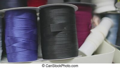 colorful spools of thread and other sewing work accessories.