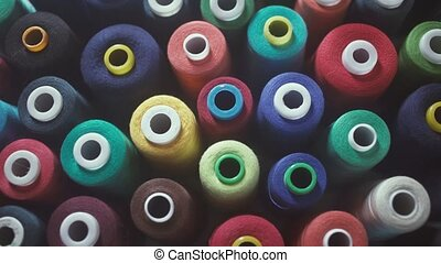Colorful spools of thread in textile factory. Textiles and Fabrics.