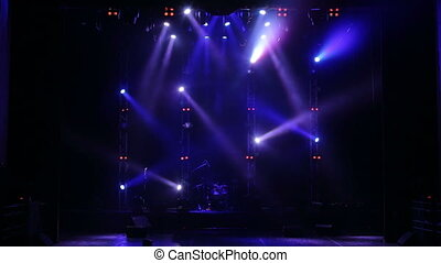 Colorful spotlight on an empty concert stage in the dark. Free stage with lights