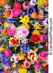 Colorful mixed bouquet with various spring flowers