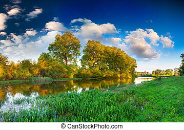 Colorful spring landscape on the river
