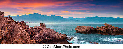 Colorful spring panorama of sunrise on the harbor Milazzo