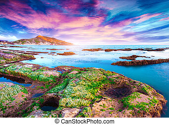 Colorful spring sunset from the Giallonardo beach