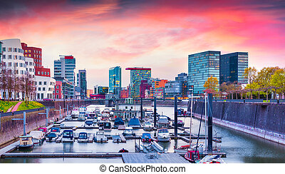 Colorful spring sunset on Rhine in Dusseldorf. Medienhafen...
