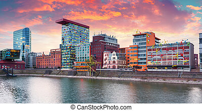 Colorful spring sunset on Rhine river in Dusseldorf. ...