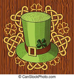 Colorful St. Patricks Day hat and ornament on wood background.