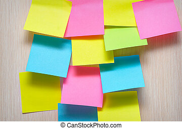 colorful stickers on a wooden background