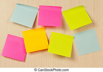 Colorful stickers on wooden board from notice