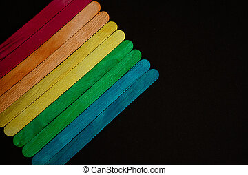 Colorful sticks isolated on black background