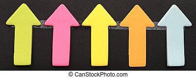Colorful sticky notes on black background