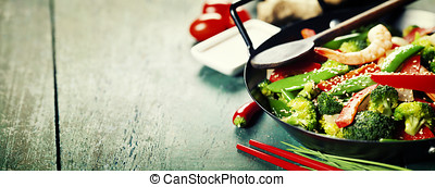 colorful stir fry in a wok - Chinese cuisine. Colorful stir...