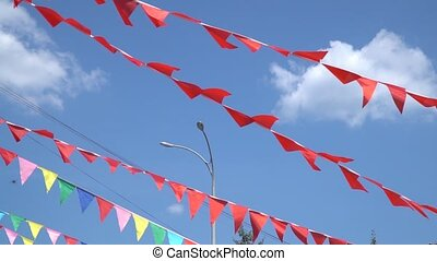 Colorful string pennant triangle flags blowing in the wind.