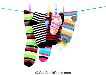 striped socks - colorful striped socks hanging on a white...