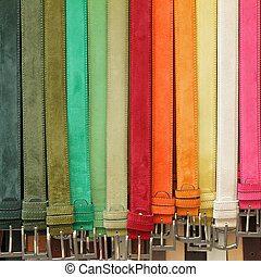 colorful suede trouser belts in shop window, Italy