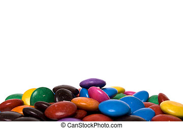 rainbow colored candy, piled up on white background