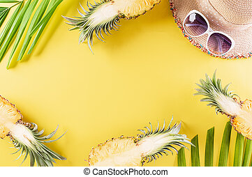 Colorful summer and holiday concept, Straw hat, sunglasses, palm branches and pineapple on yellow background.