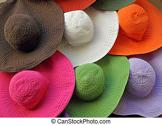 colorful summer hats in shop window - summer accessories