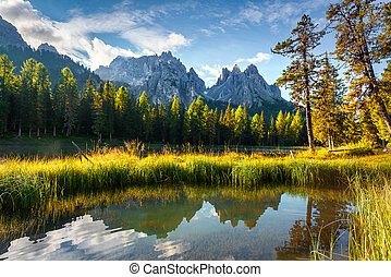Colorful summer morning on the lake Antorno