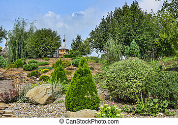 Colorful summer rockery garden at bright sunny day