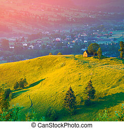 Colorful summer sunrise in the mountain village