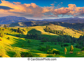 Colorful summer sunrise in the Carpathian village with...