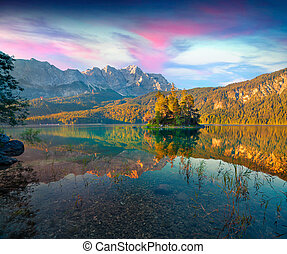 Colorful summer sunrise on the Eibsee lake in German Alps