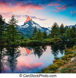 Colorful summer sunrise on the Grindjisee lake. Reflection ...