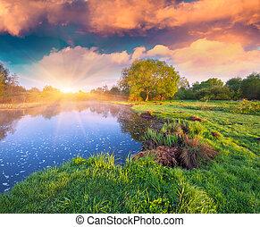 Colorful summer sunrise on the lake