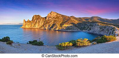 Colorful summer sunrise on the sea. Royal bay, Novy Svet, Cremea