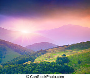 Colorful summer sunset in the mountains