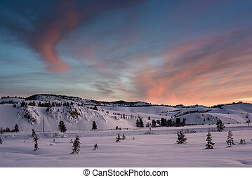Colorful sunrise over a winter meadow in Idaho