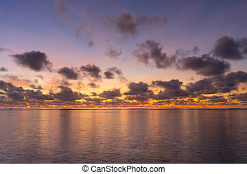 Colorful sunrise over tropical ocean